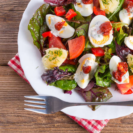 Salad with boiled egg