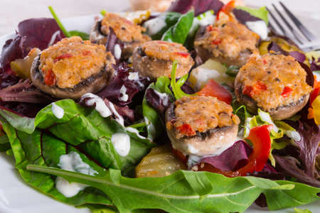 Grilled stuffed MUSHROOMS with colourful salad photo
