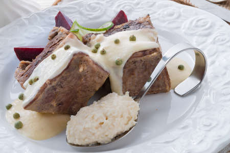 Beef with beetroot and horseradish sauce Stock Photo