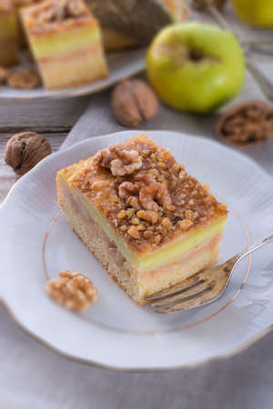 apple strudel with vanilla pudding and nuts photo