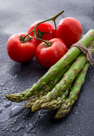 asparagus, tomatoes photo