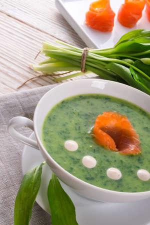 Bear allium soup with smoking salmon photo