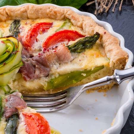 green asparagi Tart with eggs and tomato photo