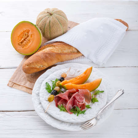 Ham with melon and olives photo