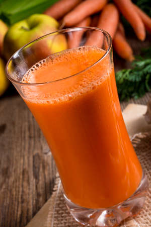 squeezed: freshly squeezed carrot juice Stock Photo