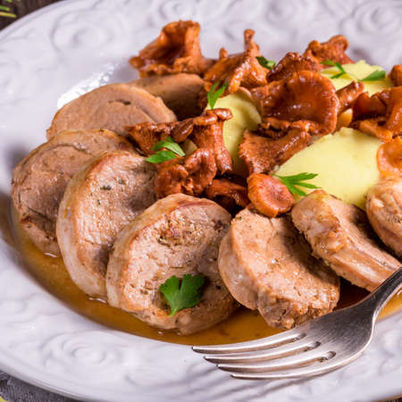 downloaded: Mashed potatoes with pork medallions and chanterelle sauce