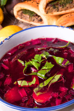beet green soup with pastries