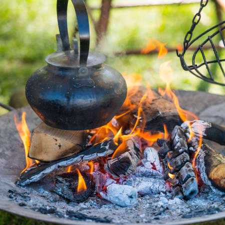 boiling: boiling over the fire