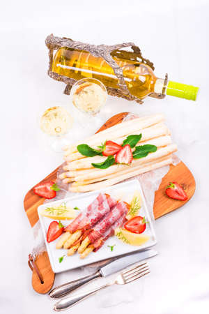 plates of food: Baked asparagus with ham Stock Photo