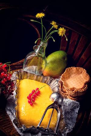 Homemade mango ice cream with currant