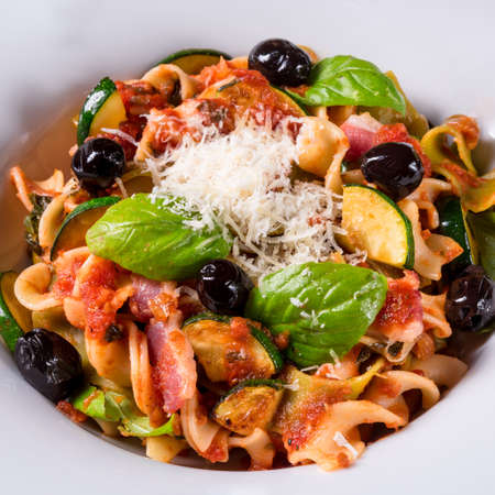 mee: Ribbon Pasta with zucchini and olives in tomato sauce