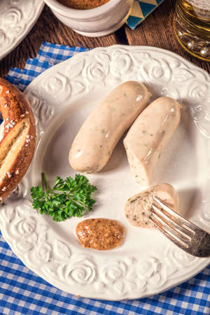 veal sausage: Bavarian sausage with pretzel, sweet mustard and beer Stock Photo