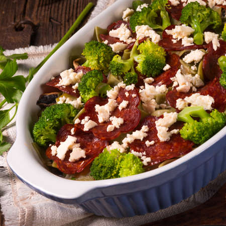 Ribbon pasta Casserole with chorizo and vegetables Stock Photo