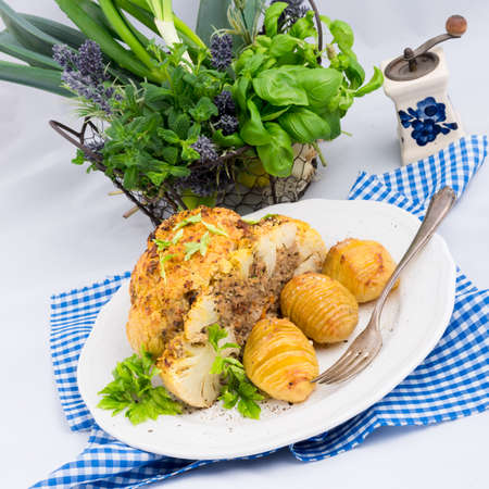 Stuffed cauliflower with mince and Hasselback potatoes