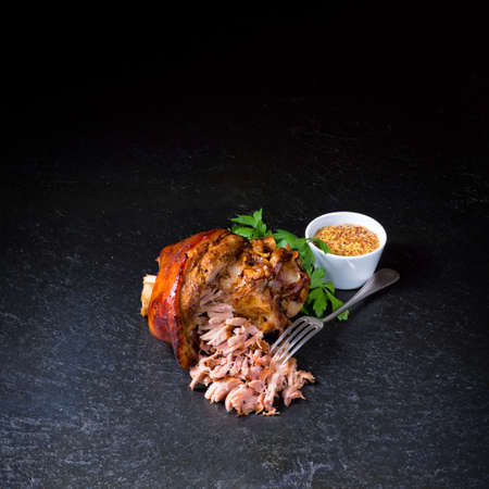 fresh roasted knuckle of pork with mustard Banco de Imagens