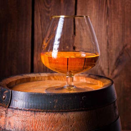 delicious bourbon on a wooden barrel Stock Photo