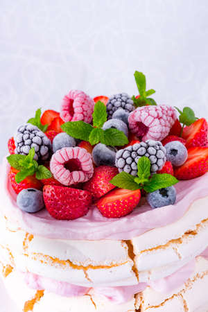 Pavlova with berry fruits Stock Photo