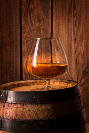 delicious bourbon on a wooden barrel Stock Photo