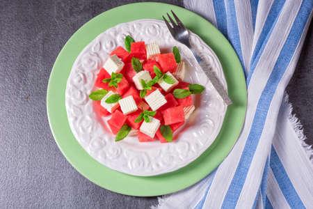 Greek Salad with watermelon, feta and fresh mint Stock Photo