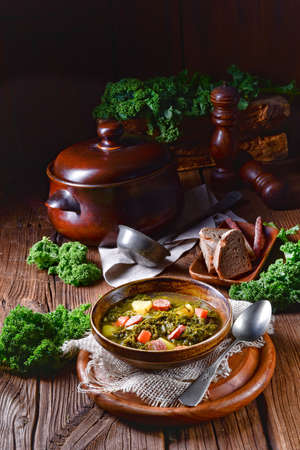 Rustic kale soup with meat and sausage Stock Photo