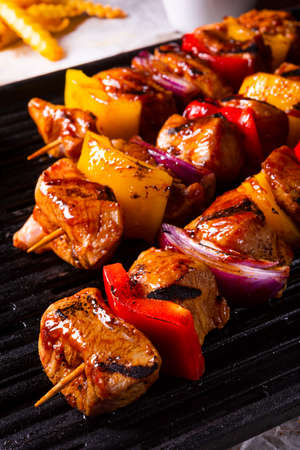 Rustic shish kebab skewers with marinated ham meat paprika and red onion Stock Photo