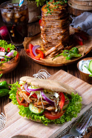Crunchy pita with grilled gyros meat. Various vegetables and garlic sauce Stock Photo