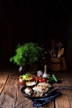 Rustic Cepelinai, a specialty Lithuanian and Polish cuisine. Stock Photo