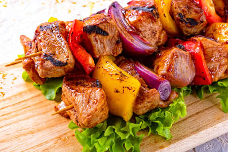 tasty and colorful meat skewers with peppers and onions