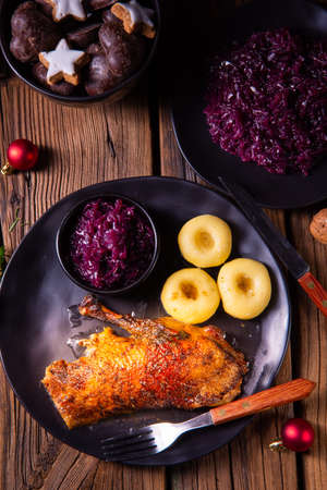classic and crispy roasted duck with cabbage and dumplings Фото со стока