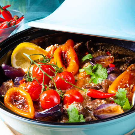 Tasty spicy beef with various vegetables cooked in tagine Stockfoto