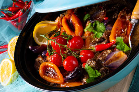 Tasty spicy beef with various vegetables cooked in tagine Foto de archivo