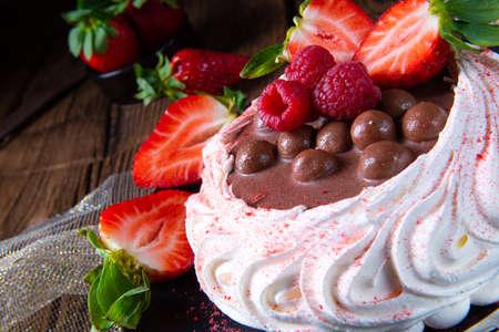 light pavlova with fresh fruits and chocolate