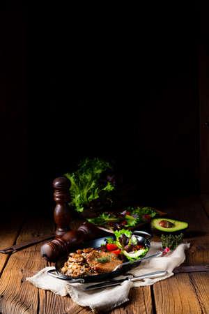 Pork steak with mushrooms and buckwheat groats and mango salad Stockfoto