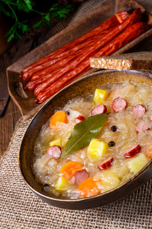 rustic sauerkraut soup with bacon and sausage Stock Photo
