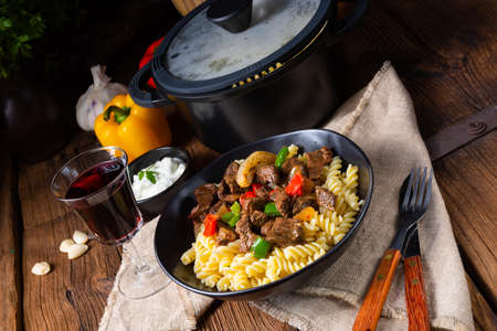 Fussili noodle with klaschise spicy goulash and paprika Stock Photo