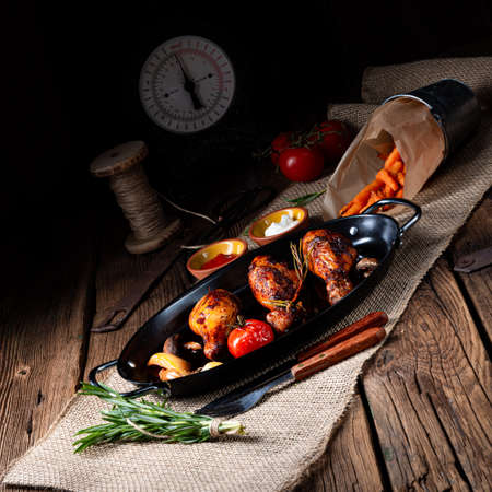 grilled chicken legs in barbecue marinade with sweet potatoes Reklamní fotografie - 125335081