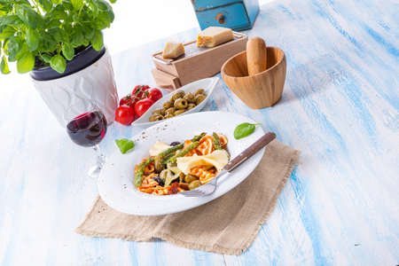 colorful farfalle with green asparagus olives and parma ham Stock Photo