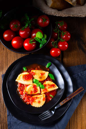 ravioli alla genovese with basil tomato sauce Stock Photo