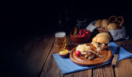 rustic Thuringian bratwurst with sauerkraut and roll Stok Fotoğraf