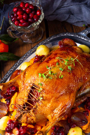 roast duck with potato dumplings and plums Stock Photo