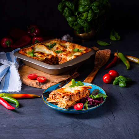 spicy lasagne with tomato sauce and basil Standard-Bild