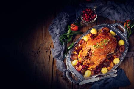 roast duck with potato dumplings and plums Stok Fotoğraf - 129312751