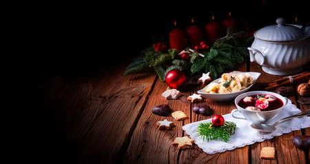traditional Polish Christmas Eve borscht with dumplings Foto de archivo - 129789526