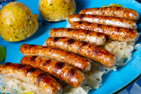 thuringian bratwurst with sauerkraut and dumplings Фото со стока