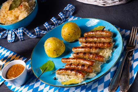 thuringian bratwurst with sauerkraut and dumplings Stock Photo