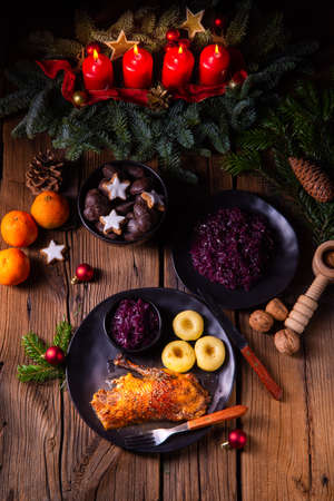 Roast goose with baked apples, red cabbage and dumplings 스톡 콘텐츠 - 129789677