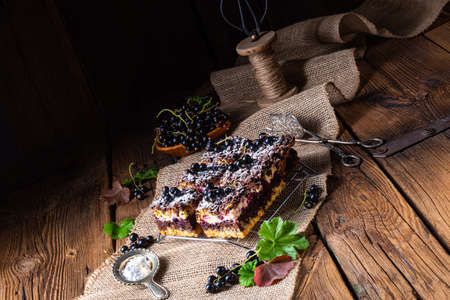 Polish cake from tin with fruit and sprinkles