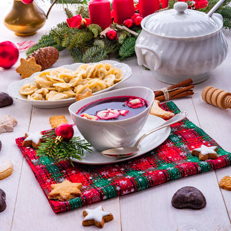 Barszcz (beetroot soup) with small pierogi Stock Photo
