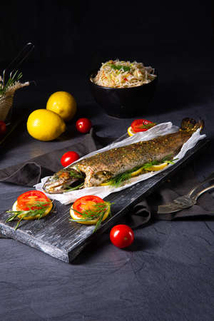 baked trout with herb filling and tomatoes Stockfoto - 130049157
