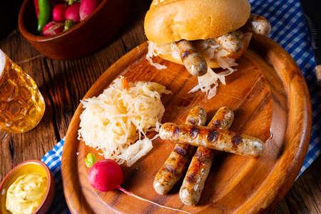 rustic Thuringian bratwurst with sauerkraut and roll